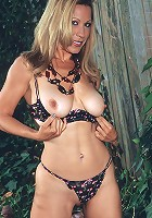 Sexy blonde mature babe with a huge red vibrator