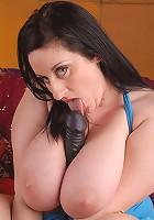 Busty chubby biatch nails herself with black dildo