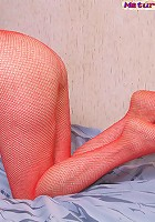 Mature stripping in red pantyhose