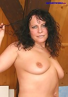 Mature brunette shows her awesome shaven pinkie