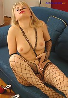 Sexy blonde mama posing in black fishnet tights