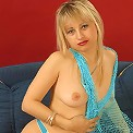 Mature temptress in a sexy tiny fishnet outfit