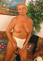 Chubby old auntie sucking a giant glass dildo