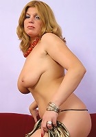Blonde mum tests a new item in her dildo arsenal