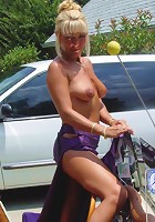 Cute Milf strips at the park