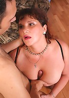 Huge mature Denise with enormous tits riding a huge cock in her black leather corset