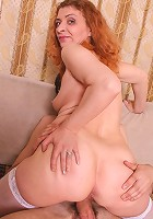 Blonde granny Ania taking off her dress and panties to ride a huge cock in the living room