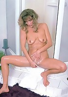 Nurse-Looking Mature Hottie Posing and Shaving Her Snatch