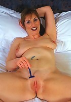Mature hooter toying her pussy with dildo