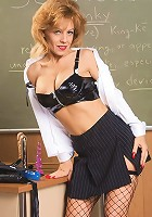Horny mature professor strips in front of her class to show off her deep pussy slit