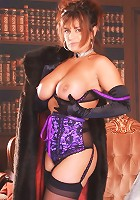 Mature redhead stripping off in a library to show off her succulent looking twat live