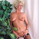 Horny mature woman with curly grey hair stripping off her clothes in this live solo clip