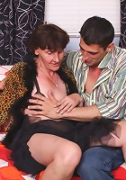 Naughty older babe Stephanie flashes her sagged breasts to lure a hunk into fucking her live