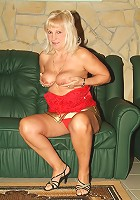 Curvy mature blonde Remy works her way into stripping off her clothes and masturbating live