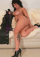 Breasty dark-haired momma strips off cowboy outfit showing off her still sexy body