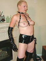 Hardcore blonde momma in BDSM suit waiting for cock satisfaction while posing