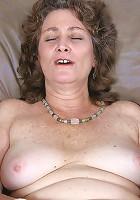 Curly brunette granny dildo fucking her unshaved pleasure hole