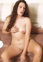 Dark-haired nasty matured slut getting naked then masturbating