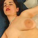 Fuck-loving whore massaging her breast while rubbing her dripping cunt.