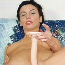 Horny whore opening wide for some great dildo-fuck.