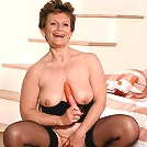 Plump older babe titty fucking orange dildo