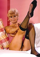 Blonde granny in sexy corset flaunting bushy box