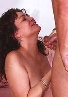 Chubby older babe riding cock while sucking huge dick