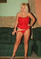 Sexy grandma Remy unleashes her big flabby knockers to play with it and pose naked for the camera