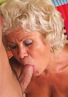 Sexy grandma Francesca strips off her clothes and lures a younger guy into eating out her slit