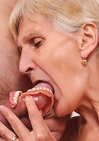 Naughty granny Irene removes her dentures to work a cock with her toothless blowjob and gets jizzed