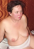 Heavyweight granny showing off in her bed