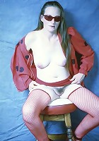 Brunette mom displaying assets in the studio