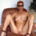 Funky momma posing naked in the living room
