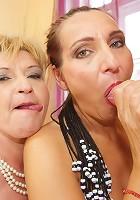 Two hot mature slut sharing one warm creampie