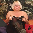 Big mature madame playing with her pussy