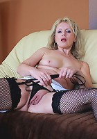 Horny blonde housewife getting naughty on the couch