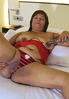 Big titted mama playing with her wet pussy