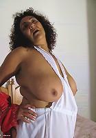 Big mature Madhia gets off on a big toy