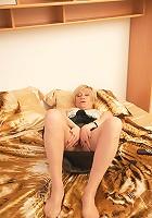 Naughty mature Eranka masturbating on her bed