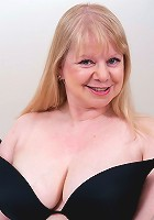 Big breasted mature slut having a good time