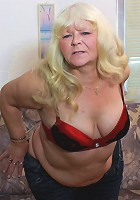 Horny mature housewife playing with herself