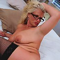 Big breasted MILF getting horny