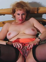 Mature slut playing with herself