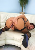 Naughty mature slut playing on the couch