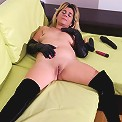 Slutty housewife playing with her toy