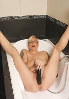 Naughty blonde mature slut getting wet in her bathtub