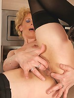 Blonde housewife gets frisky in the kitchen