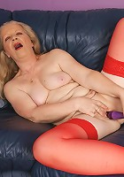 Naughty blonde mature slut masturbating on her couch