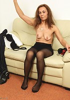 Kinky mature slut playing with her pussy on the couch