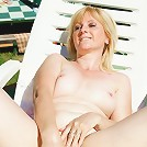 Horny mature slut playing with herself in the sun